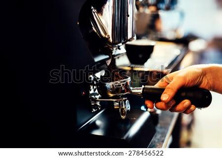 Closeup of barista grinding coffee