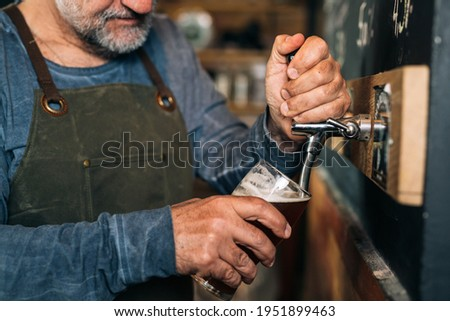 closeup of barman serving beer in pub Stock photo ©