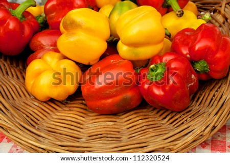 Closeup of basket of colorful sweet bell peppers at Delaware farm market