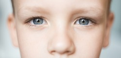 Closeup of beautiful boy eye. Beautiful grey eyes macro shot. image of a little kid eye open