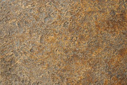 Closeup of beautiful cement wall paint in warm golden and copper tone with texture and rough surface for cool and grunge background and rusty wallpaper