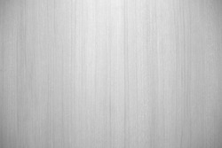 Closeup of beautiful glossy wooden wall in black and white or grey tone with texture for simple background. Cool banner on ad, website, page, and presentation. Monochrome modern  pattern
