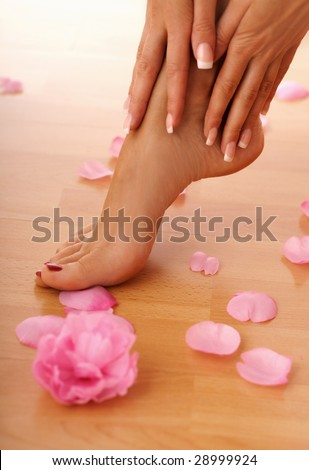 closeup of beautiful human legs and hands.  human feet. SPA and wellness