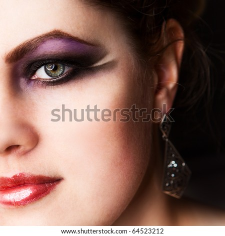 closeup of beautiful woman'face with bright makeup