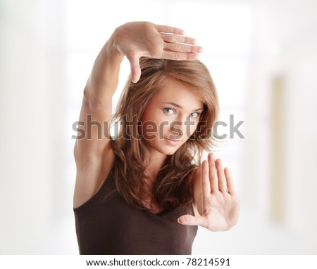 Closeup of beautiful woman making frame with her hands