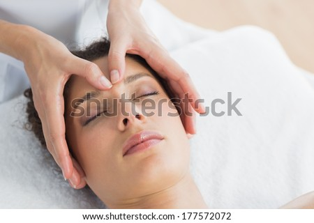 Closeup of beautiful young woman having head massage in health spa #177572072