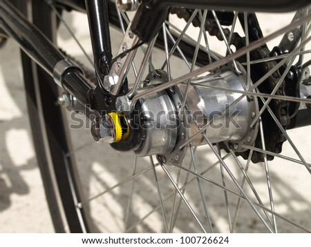 Closeup of bicycle tire with spokes on white background