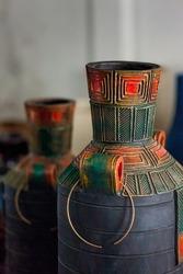 Closeup of big black vase made up of clay at warehouse.