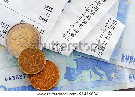 closeup of bills and euro banknotes and coins macro