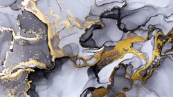 Closeup of black and shiny golden alcohol ink abstract texture, trendy wallpaper. Art for design project as background for invitation or greeting cards, flyer, poster, presentation, wrapping paper