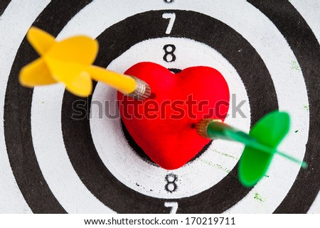Closeup of black and white target with two dart in red valentine heart love symbol as bullseye. Skeet trap shooting sport in valentines day. #170219711