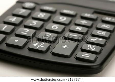 closeup of black calculator on white background