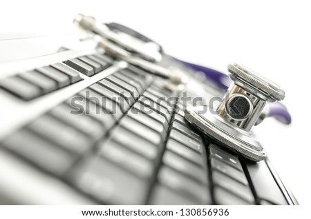 Closeup of black keyboard with stethoscope. Shallow depth of field. - stock photo