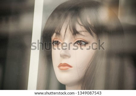 closeup of black wig on mannequin in fashion store showroom #1349087543