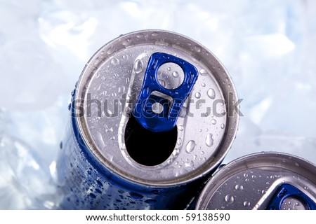 Closeup of blue drink can on ice background - stock photo