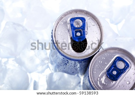 Closeup of blue drink can on ice background