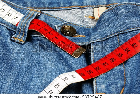 Closeup of blue jeans and measure tape