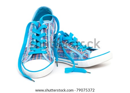 Closeup of blue sneakers with shoelaces isolated on white background