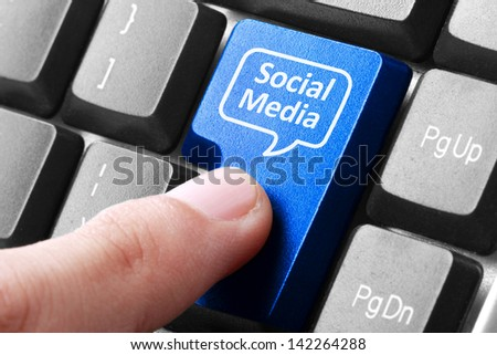 Closeup of blue social media button on the keyboard
