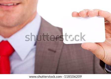 Closeup of blurred business man holding a blank business card on focus
