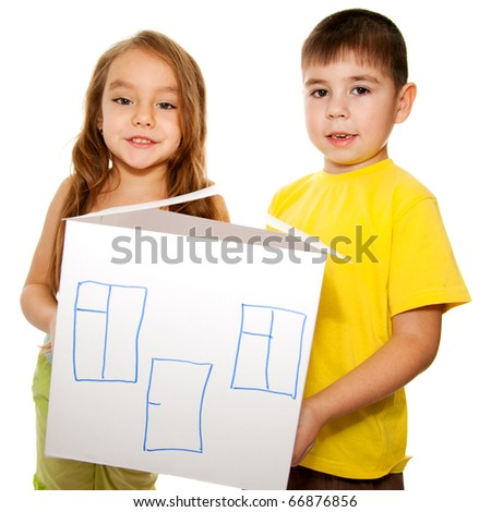 Closeup of boy and girl are holding house model isolated on white