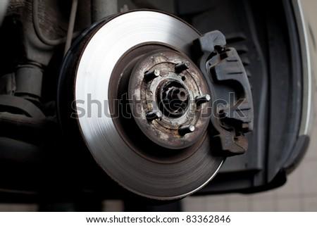 Closeup of brake disc mounted on car - stock photo