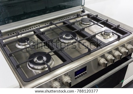 closeup of brand new, modern gas stove on countertop in contemporary modern home kitchen. #788120377