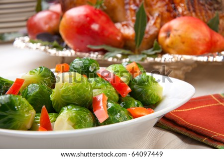 Closeup of brusssels sprouts with roasted bell pepper.