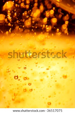Closeup of bubbles an wineglassess champagne