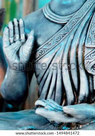 closeup of Buddha idol,hand in blessing pose