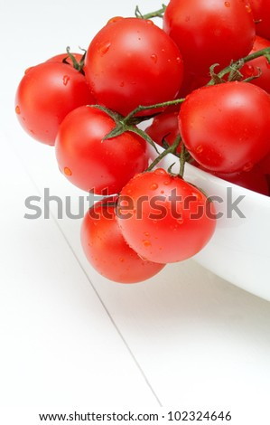 Closeup of Bunch of Fresh Cherry Tomatoes in White Bowl