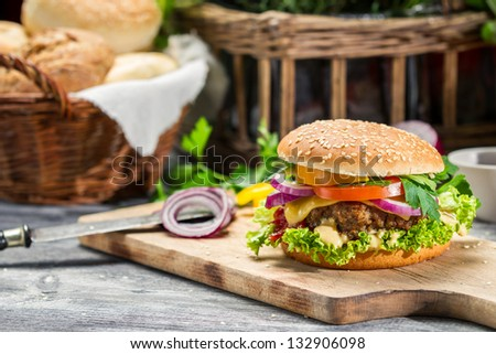Closeup of burger made �¢??�¢??from beaf and fresh vegetables