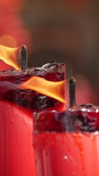 Closeup of burning red candles at Temple.
