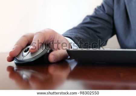 Closeup of  business man's hand  working on computer stock photo