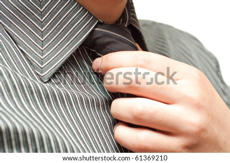 closeup of business man tying a tie