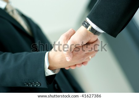 Closeup of business people shaking hands over