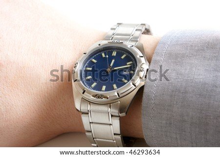 Closeup of businessman's hand with wristwatch