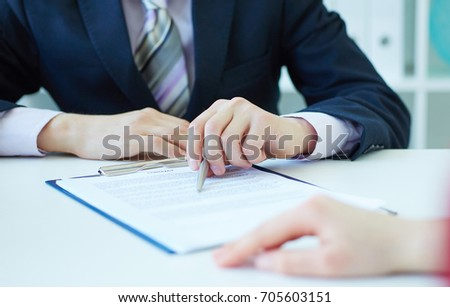 Closeup of businessman's hands showing  his new business partner the terms of the agreement or contract. Selective focus. Selective focus. #705603151