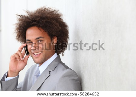 Closeup of businessman talking on the phone