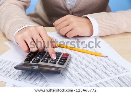 Closeup of businesswoman hands, working in office room