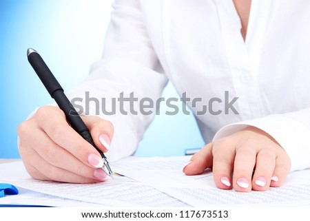 Closeup of businesswoman hands, writing on paper