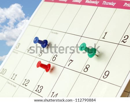 Closeup of Calendar Page with Marked Important Days