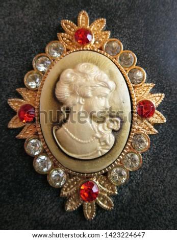 Closeup of cameo ornament on handbag #1423224647