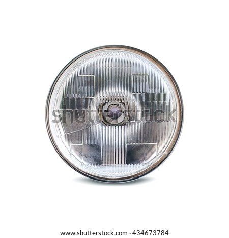 Closeup of car headlight isolated on white background, Clipping path included.