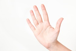 Closeup of caucasian female caucasian hand isolated on white background. Young woman shows 5 fingers while counting. Horizontal color image