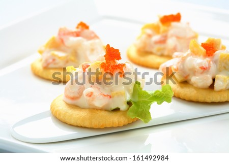Closeup Of Caviar And Cream Cheese Appetizer On Crackers