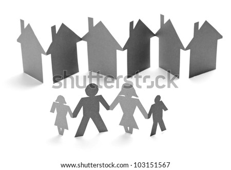 closeup of chain of paper people and houses cut on white background