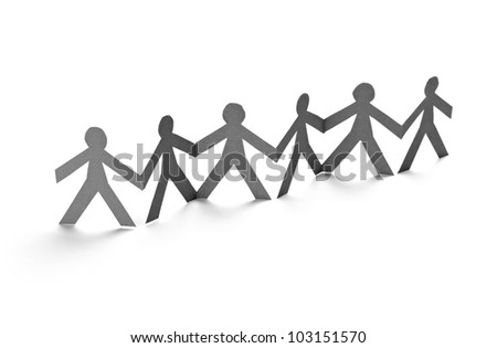 closeup of chain of paper people cut on white background