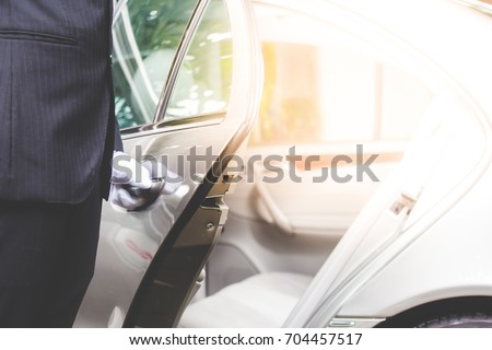 Closeup of chauffeur opening car door Foto stock ©