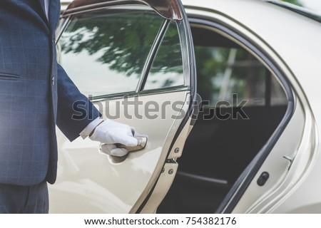 Closeup of Chauffeur opening car door with glove #754382176